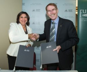 Dr Tangerine Holt and Professor Ian Young shake hands to officiate the Fulbright-ANU Distinguished Chair agreement