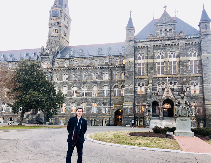 Aiden Warren stands in front of Georgetown University, Washington DC