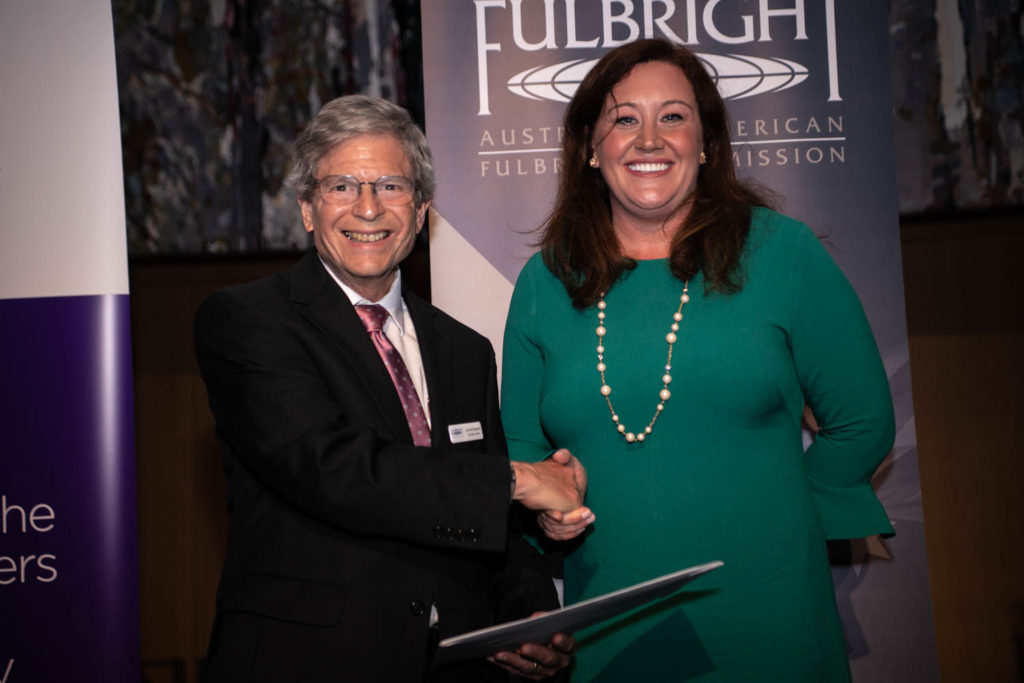 Professor Donald Shepherd receiving his Fulbright certificate from Deputy Assistant Secretary Caroline Casagrande at the 2019 Fulbright Presentation Dinner