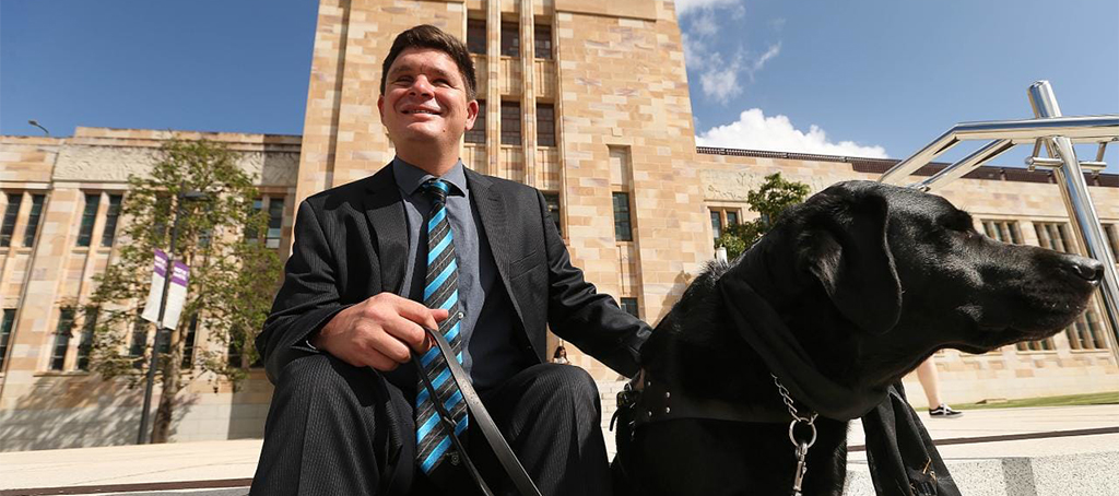 Fulbright Scholar Dr Paul Harpur, with his guide dog, Sean at the University of Queensland